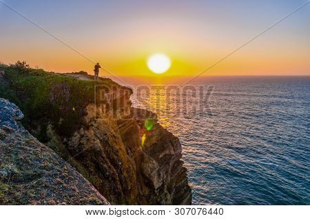 Sunset At Atlantic Rocky Coast, Portugal. Photographer Taking Shot Of Andscape.