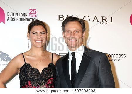 LOS ANGELES - MAR 4: Anna Musky-Goldwyn, Tony Goldwyn at the 2018 Elton John AIDS Foundation Oscar Viewing Party at the West Hollywood Park on March 4, 2018 in West Hollywood, CA
