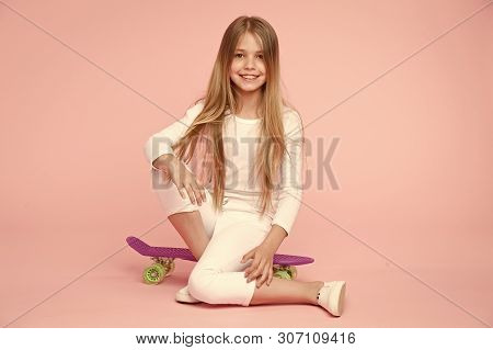 Little Girl Sit On Penny Board. Happy Little Girl Enjoy Happy Childhood. Childhood Development And G