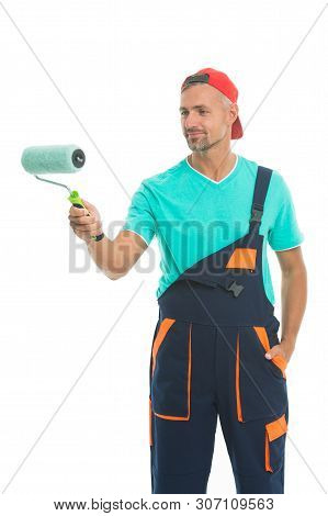 Paint And Renovate. Decorator Painting Wall. Man In Cap Hold Paint Roller White Background. Worker P