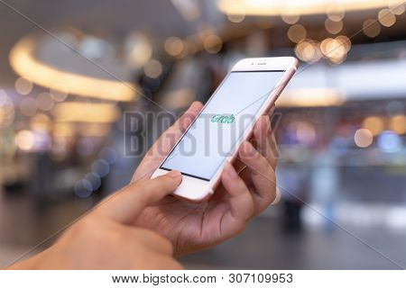 Chiang Mai, Thailand - May.10,2019: Woman Holding Apple Iphone 6s Rose Gold With  Grab Apps On Scree