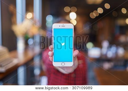 Chiang Mai, Thailand - Apr.08,2019: Woman Holding Apple Iphone 6s Rose Gold With Twitter App.twitter