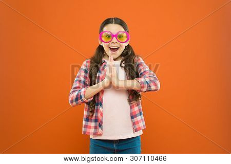 Perfect For Summer Party. Happy Party Girl On Orange Background. Adorable Little Kid Wearing Party G
