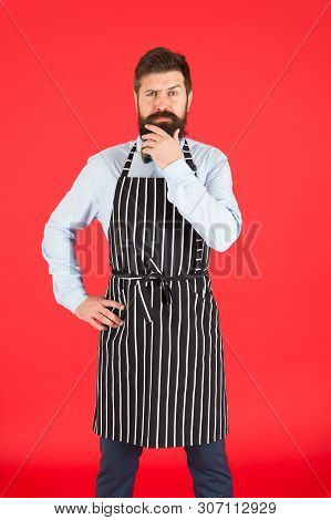 Thinking About New Recipe. Elegant Waiter Man Or Bartender. Bearded Man Wearing Bib Apron. Man Cook