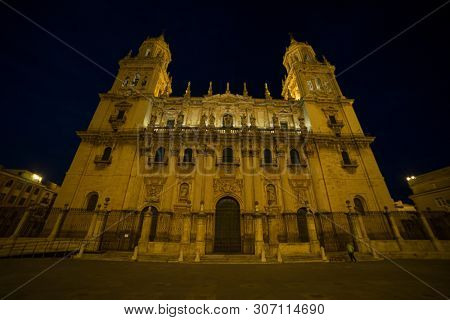 Renaissance, Jaen cathedral illuminated at night. Summery image with the empty streets of the city of Jaen in Spain