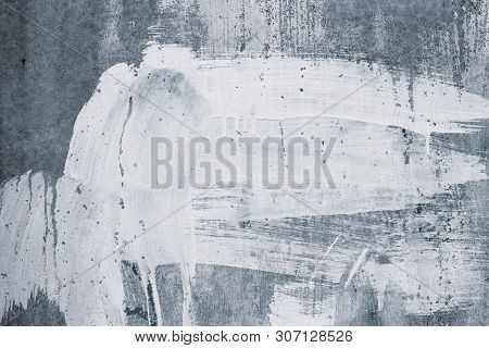 Abstract Pattern Of White Paint Stains On Grey Concrete Wall. Paint Drips On Gray Backdrop. Rough Su