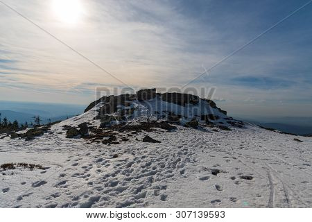 Pecny Hill With Quartzite Rock Formation, Snow And Hills On The Background In Jeseniky Mountains In
