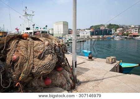 Keelung, Taiwan - September 5, 2018: Fishing Nets With Red Floats Lay On A Coast In Keelung Port