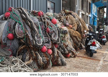 Keelung, Taiwan - September 5, 2018: Fishing Nets With Red Floats Lay In Keelung Port