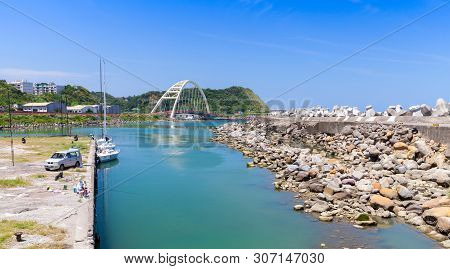 Keelung, Taiwan - September 6, 2018: Coastal Panoramic Landscape Of Keelung City With Fishermen Near
