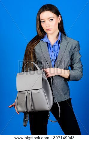 Woman With Leather Knapsack. Stylish Woman In Jacket With Leather Backpack. Formal Style Accessories