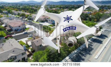 Police Unmanned Aircraft System, (UAS) Drone Flying Above A Neighborhood and Street.