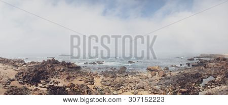 Rocky Shore With A Cloudy View Over Atlantic Sea In Portugal