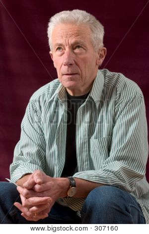 Senior Man Sitting In Relaxed Pose