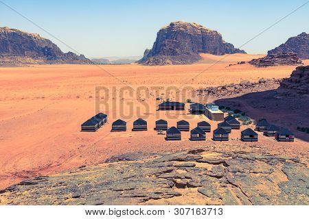 Red Sand Desert And Bedouin Camp At Sunny Summer Day In Wadi Rum, Jordan. Middle East.