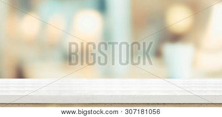 Empty White Wood Table And Blurred Soft Light Table In Restaurant With Bokeh Background. Product Dis
