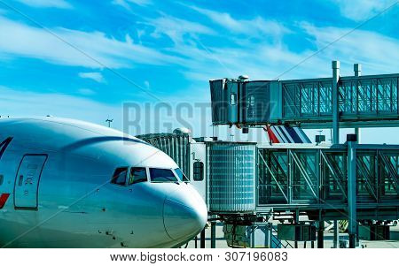 Commercial Airline Parked At Jet Bridge For Passenger Take Off At The Airport. Aircraft Passenger Bo
