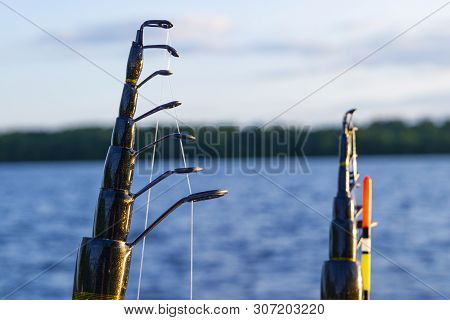 Fishing Rod With The Line And Float Close-up. Fishing Rod In Rod Holder In Fishing Boat Due The Fish