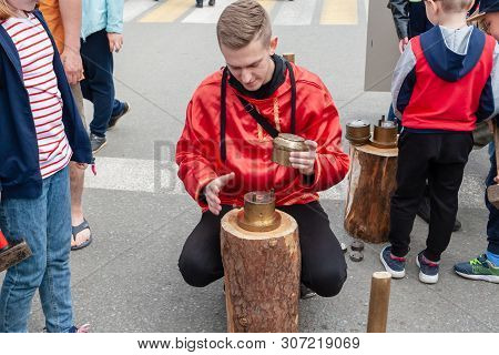 Surgut, Russia, 06.12.2019: Master Blacksmith Demonstrates Coinage And Offers To Try Wishing.
