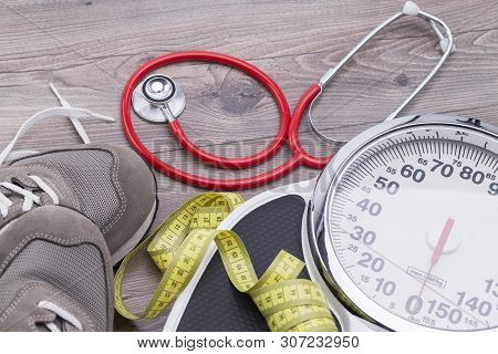 Healthy Concept With Sport Shoes, Stethoscope And Weighing Scales