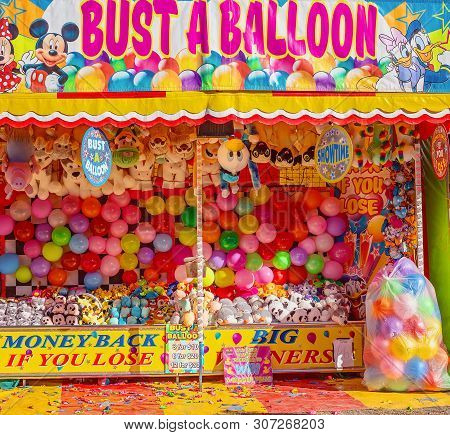 Mackay, Queensland, Australia - June 2019: A Game Of Chance Busting Balloons To Win A Price At Macka