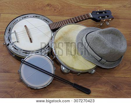 A Samba Player (sambista) Hat And Three Brazilian Musical Instruments: Samba Banjo, Pandeiro (tambou