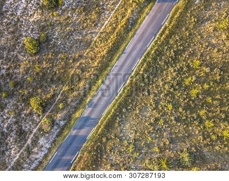 Road Through Barren Landscape In Cevennes Near Ganges, Occitania, France
