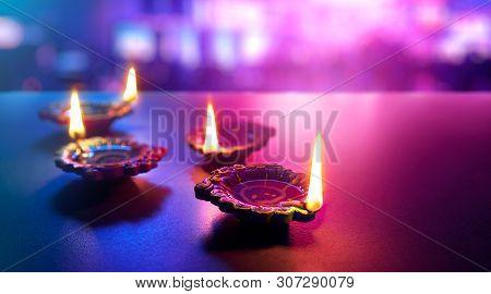Happy Diwali - Colorful Clay Diya Lamps Lit During Diwali Celebration