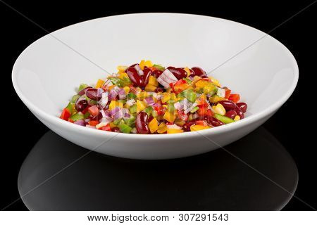 Mexican Salad With Reflection Isolated On Black Background. Studio Shot