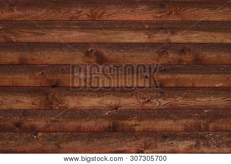 Texture Of Brown Shabby Wooden Fence. Old Wooden Boards With Nails. Pattern Of Wooden Surface Of Log