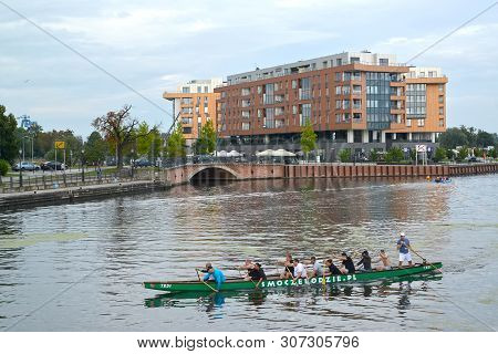 Gdansk, Poland - August 24, 2018: A View Of The Motlava River With The Canoe Floating On Water
