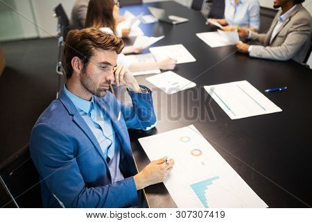 Group Of Unsuccessful Business People And Badly Managed Company Leads To Unhappiness