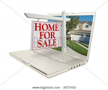 Home For Sale Sign & New Home On Laptop