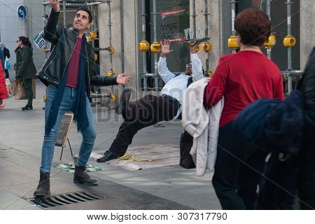 Madrid, Spain - November 11,2017 : Unidentified Young Man Takes A Selfie Photo With A Street Perform