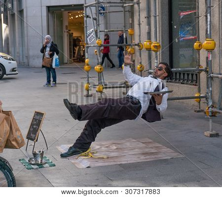 Madrid, Spain - November 11,2017 : Unidentified Street Performer Act Like He Is A Waiter Slipping On