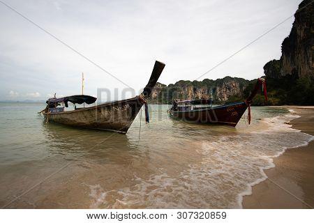 Railay Beach, Thailand - May 7, 2016 : Two Wooden Boats On Railay Beach, Thailand.