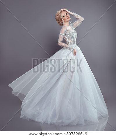 Beautiful Bride In Wedding Flowing Chiffon Dress, Woman In Long Flying Blowing Gown. Stunning Fashio