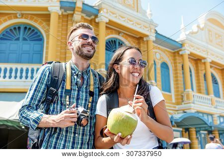 Young Interracial Couple Tourist Backpackers Enjoying Traveling In Bangkok City Thailand On Summer H