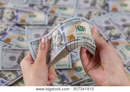 Man Hands Counting 100 Dollar Bills. In The Hands Of A Lot Of Cash, 100 Denominations Of Dollars