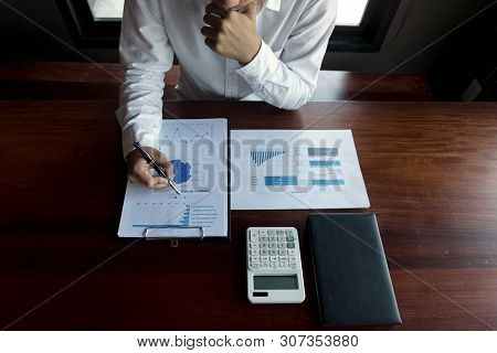Businessmen Calculate Investment Expansion Business, Saving Money .finance Concept .