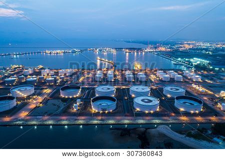 Aerial View Or Top View Night Light Oil Terminal Is Industrial Facility For Storage Of Oil And Petro