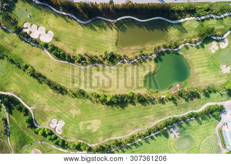 Aerial View Photography Of Forest And Golf Course With Lake. Golf And Sport Club.