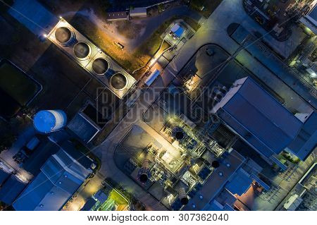 Aerial View Night Light Oil Terminal Is Industrial Facility For Storage Of Oil And Petrochemical. Oi