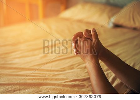 Christian Hands Raised To Worship For Bless God With Good Fortune In His Bedroom. Eucharist Therapy