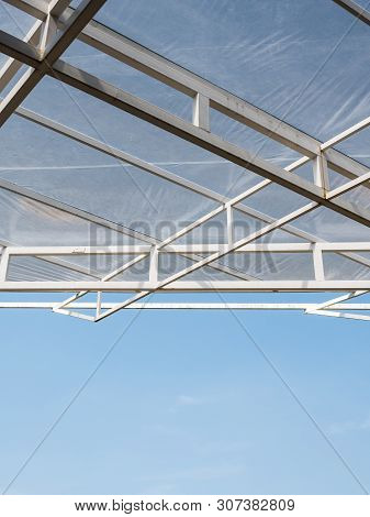 Metal Frame Of The Modern Canopy In The Factory Which Under The Clear Blue Sky.