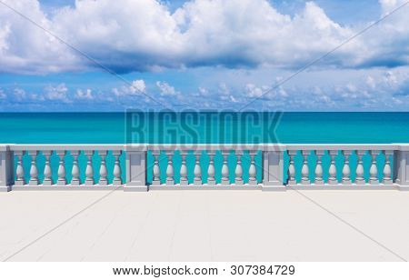 White Blank Terrace with Balustrade Overlooking Turquoise Ocean. Summer Background. 3D Illustration.