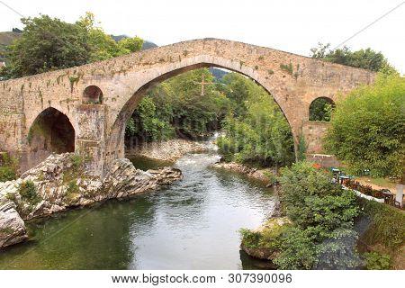 Roman Arch Bridge Over A Creek. Covadonga, Spain