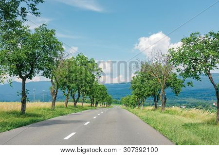 Asphalt Road Through Fields In To The Mountains. Beautiful Summer Countryside Scenery Of Slovakia. T