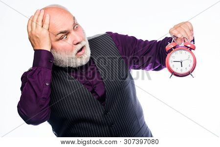 Time Does Not Spare Anyone. Time And Age Concept. Bearded Man Clock Ticking. Aged Man Holding Alarm