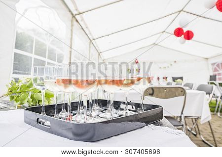 Drinks On A Table In A Bright Tent At A Party In Daylight